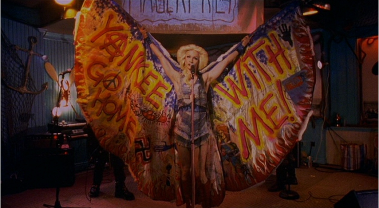 Hedwig and the Angry Inch in denim wings